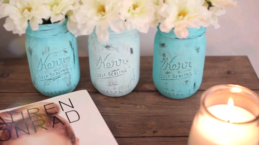 Using Paint On A Mason Jar And Filling It With Flowers Is A Great Way To