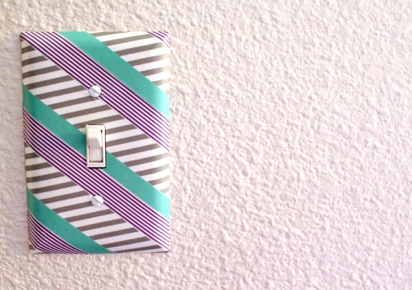 Washi tape is a great way to make small improvements to a room without a lot of mess or fuss, and it's perfect for dorm rooms as well! Dress up your plain white switch plates with a bit of tape for color and style.