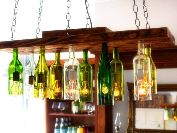 Wine bottle chandeliers are incredibly popular for industrial and even farmhouse style homes, but a custom made one can get very pricey. Experienced DIYers can take on this project to create their very own customized wine bottle chandelier! This is a super cool DIY room décor idea.