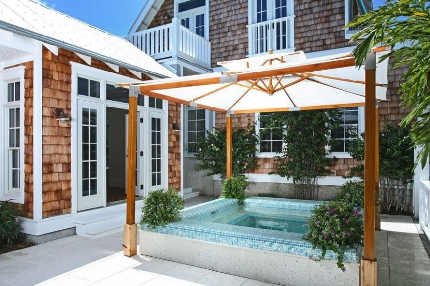 This cloth top gazebo is a great piece for putting over a hot tub. You can place it there when you need it, but it can also remain closed when you no longer need the covering.