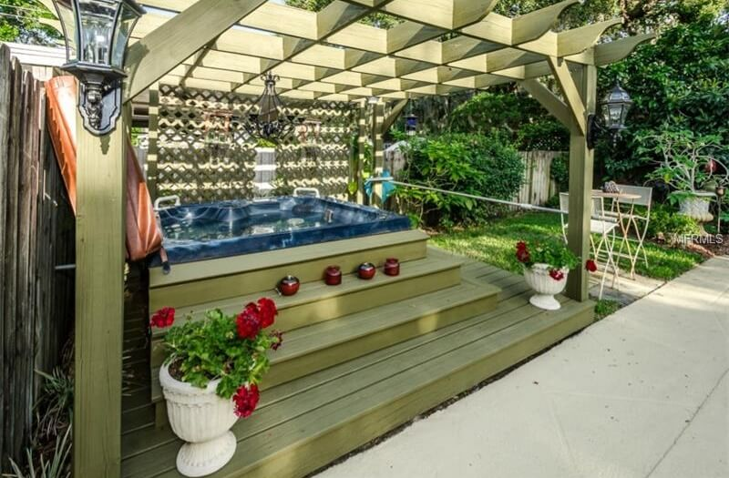 This is a nice shady escape where you can can lay back and let your worries drift away. Adding candles and flowers transforms this hot tub space into the perfect romantic getaway in your own backyard.
