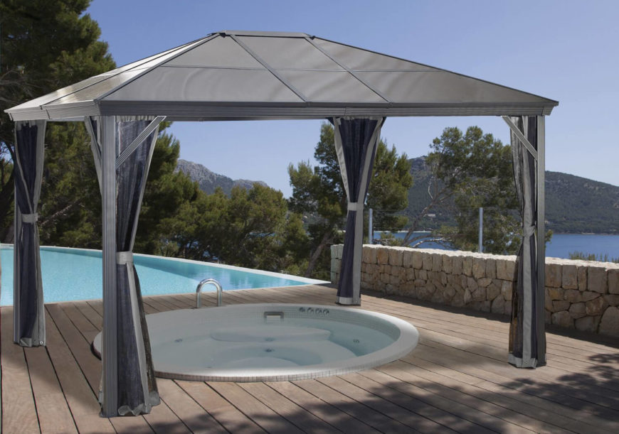 This hot tub is covered by a portable gazebo. This kind of gazebo is ideal when you don't always want your hot tub covered. You can remove it when you desire a clear view of the stars, then replace it if you need extra shade and privacy.