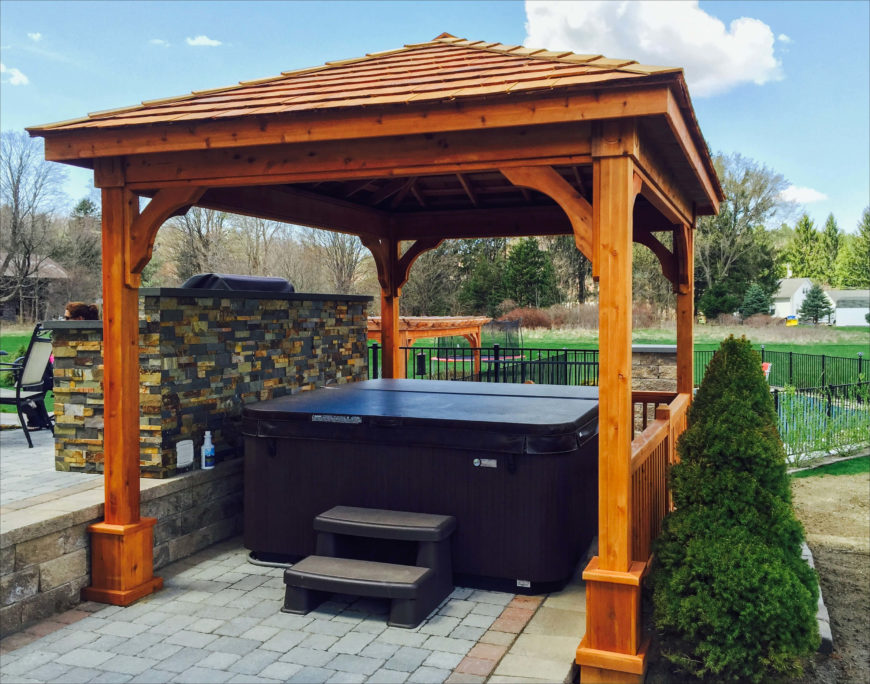 This beautiful wooden gazebo is a great addition to any yard for any reason. It also turns out to be the ideal size and shape to house a nice above ground hot tub. This hot tub space is a fantastic getaway for anyone who wants to escape from the world.