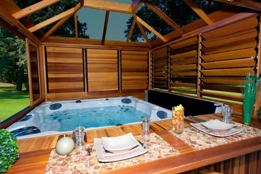 this gazebo is built to fit snugly around this hot tub creating a cozy and - Hot Tub Design Ideas