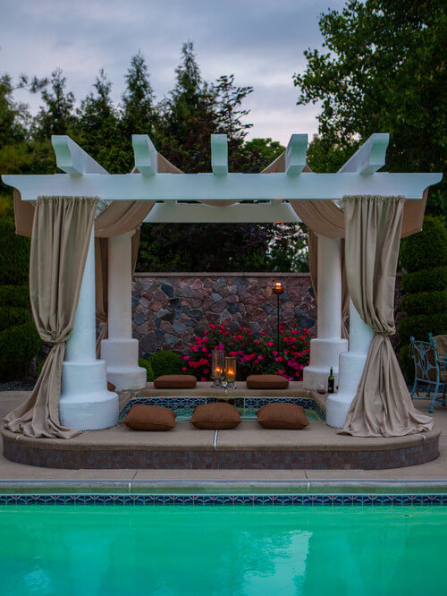 Draping curtains from your gazebo and adding pillows and candles can transform your hot tub into an elegant romantic destination for you and your significant other.