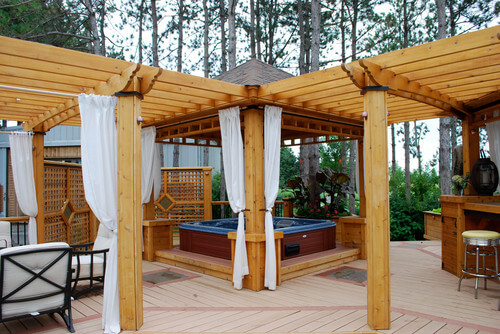 This gazebo has multiple different sections, one of which is dedicated to  housing a hot - 26 Spectacular Hot Tub Gazebo Ideas