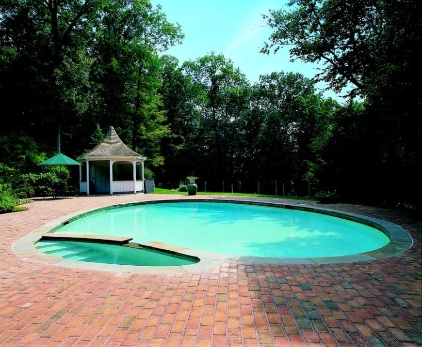 This simple gazebo with enclosed walls is a wonderful companion to a pool. This space can serve many purposes and provide extra utility to the pool.