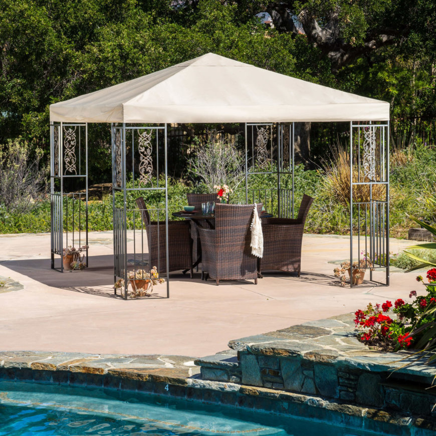 This gazebo is outfitted with relaxing chairs and a nice table that acts as a dining area. A small gathering of friends would be more than happy to hang out in this shady area by the pool.