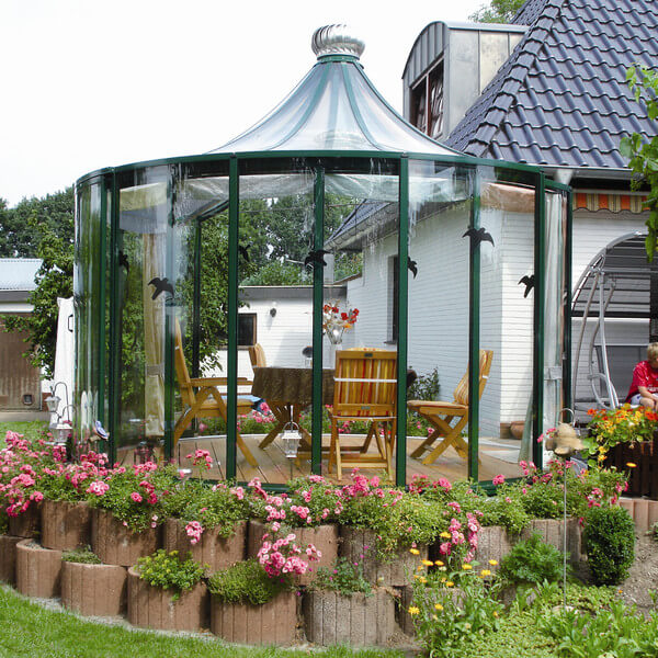 This unique gazebo has glass walls and top which give great visibility while still providing protection from some of the elements. Not only does it offer protection but it is also a beautiful addition that will surely grab attention.