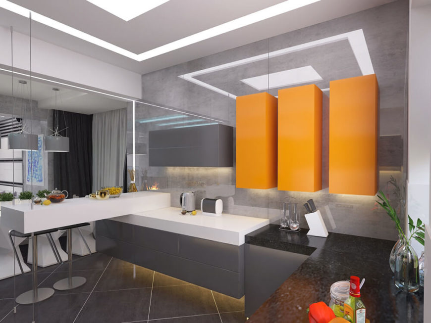 Within the kitchen, one of a handful of colorful bursts appears, courtesy of bright orange floating cabinets. The dark quartz countertops at the right offer a blush of contrast to the kitchen.