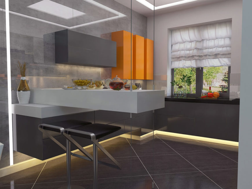 The kitchen countertop extends to this floating island component, offering a space for in-kitchen dining. Thin cables support the structure unobtrusively.