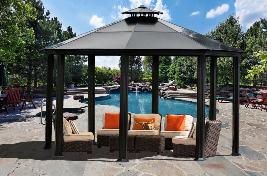 Metal gazebos such as this one can go anywhere. You can move them on a whim or leave them where you like. This gazebo sits poolside and covers a set of great relaxing patio furniture.