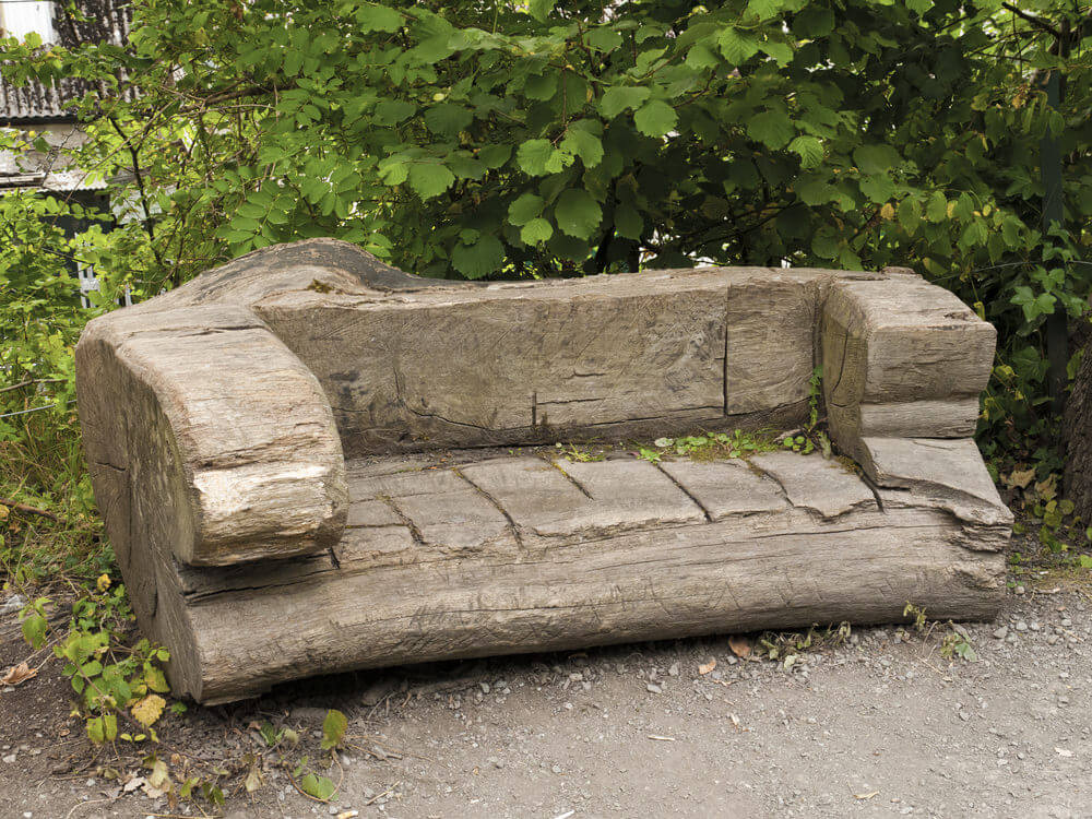 This is an entire tree trunk designed into a bench and intricately carved in the middle to form a hollow seat.