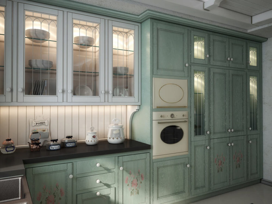 The richly painted cabinetry stands as one of the more unique cupboard colors we've ever seen. in contrast, a set of glass door cabinets appears to the left.