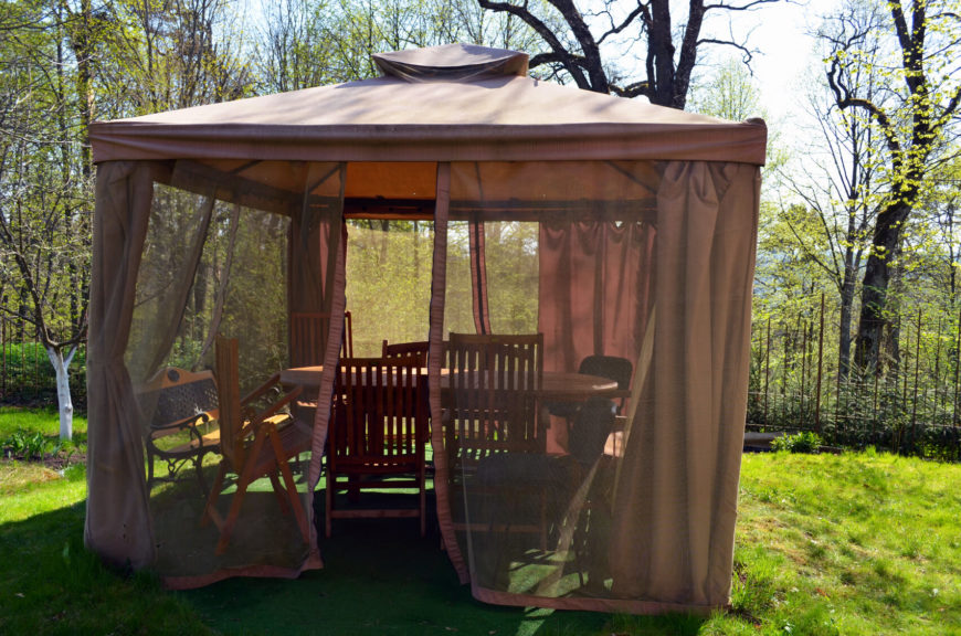 This gazebo has a screen curtain as well as a thicker curtain. The screen curtain can be used to keep out the bugs, while pulling closed the thicker curtain will build privacy.