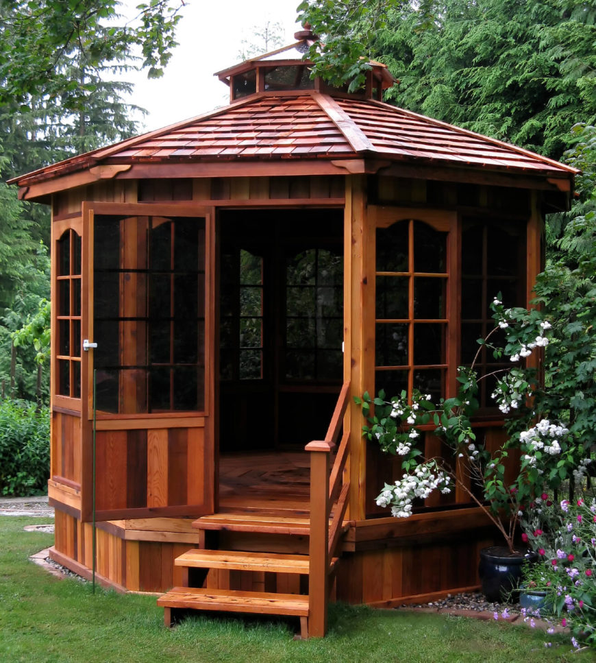 The rich hardwood tones of this wooden gazebo make it a beautiful addition to any yard. Relaxing under this gazebo in a comfy chair with a good book is a dream way to spend an afternoon.