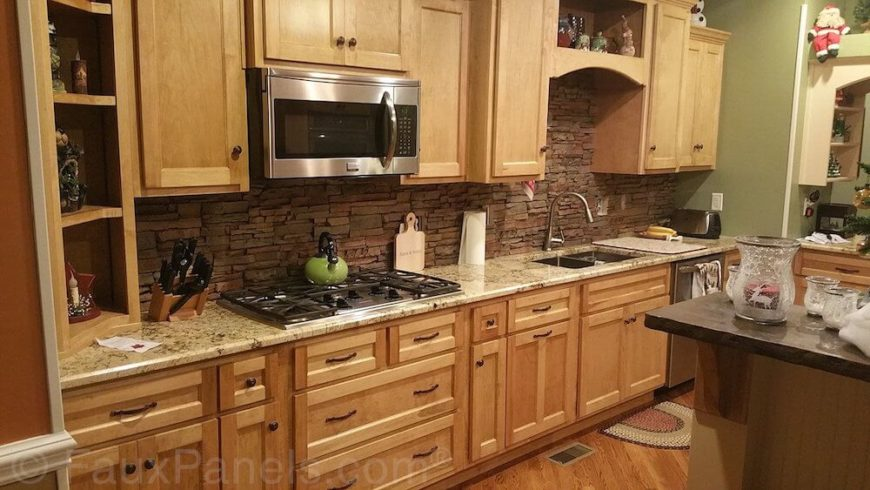 Marvelous Backsplash Panel Ideas Part - 9: A Dark Layered Stone Backsplash Adds Texture And Contemporary Style To This  Light Wood And Granite