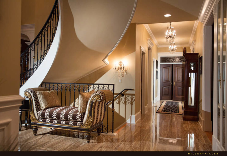 The Rich Flooring, Detailed Molding, And Luxurious Furniture Appearing  Throughout The Entry Is A