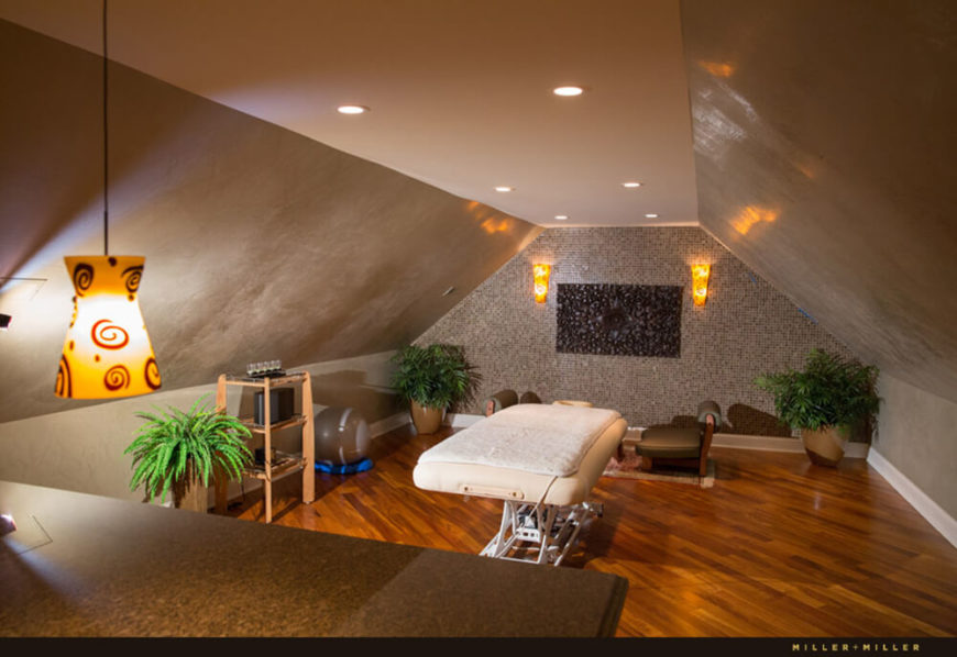 Not many private residences have a full spa and massage room, but this home features a truly luxurious example, with rich hardwood flooring and an intricate tile feature wall.