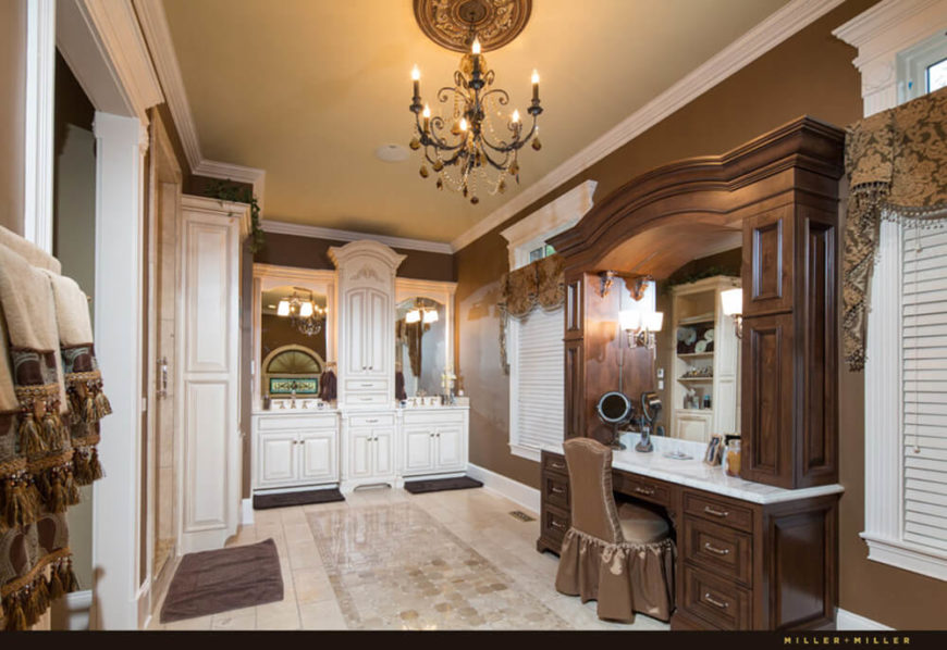 Similarly, the master bath is awash in rich materials, from ornate wood and marble vanity to the marble flooring. A chandelier hangs in this room, illuminating every curve and fold of the molding and window frames.