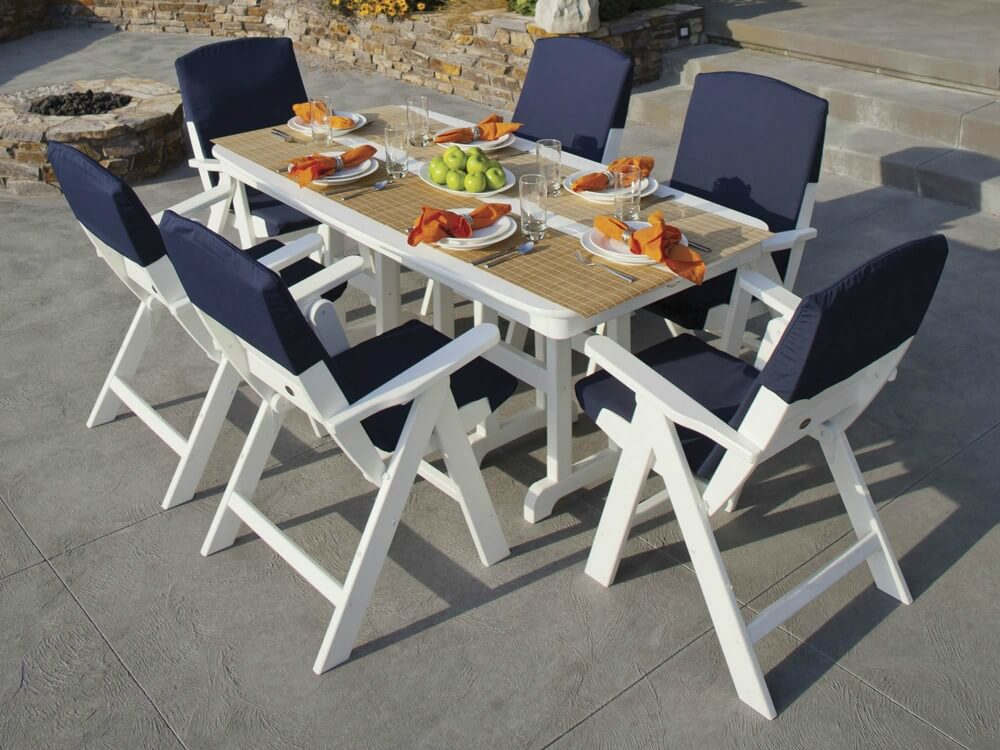 Coastal style white and navy blue patio chairs with white dining table