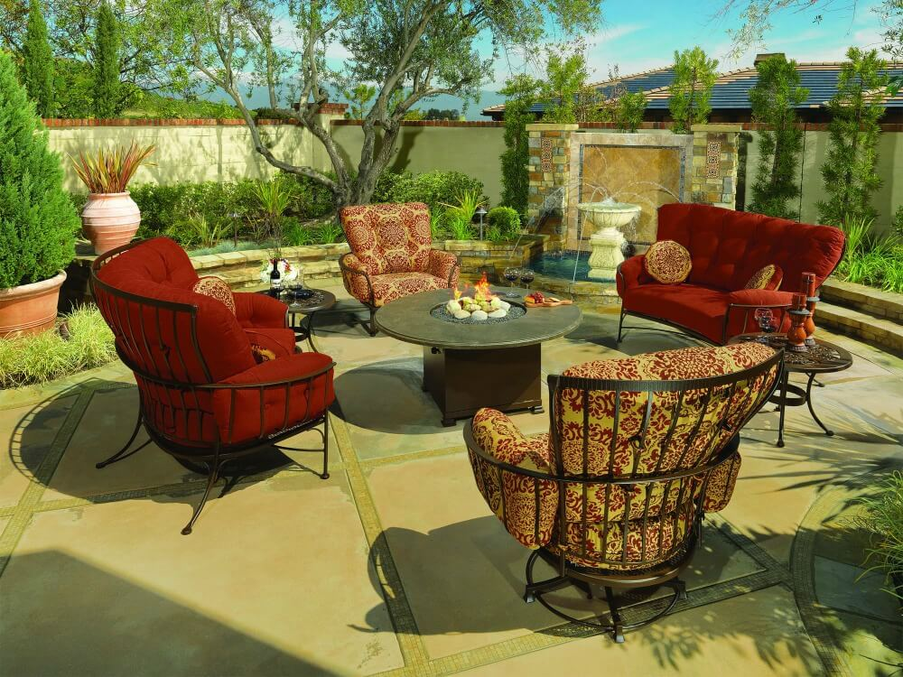 Formal outdoor patio furniture set with large cushioned chairs and small sofa