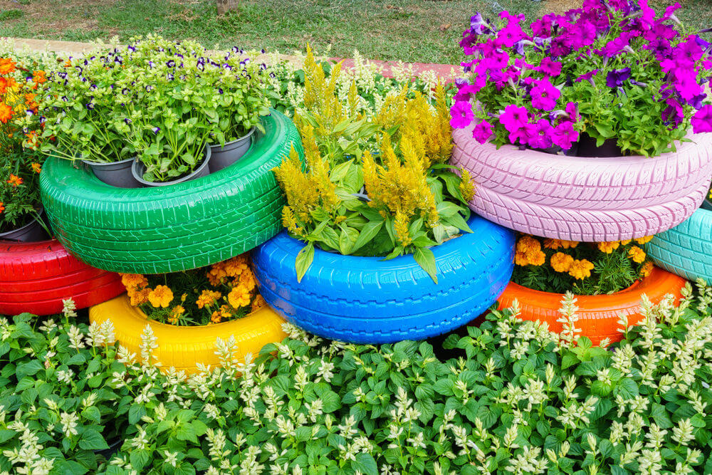 3 rows of colorfully painted tires stacked on top of one another to create a multi - Garden Ideas Using Tyres