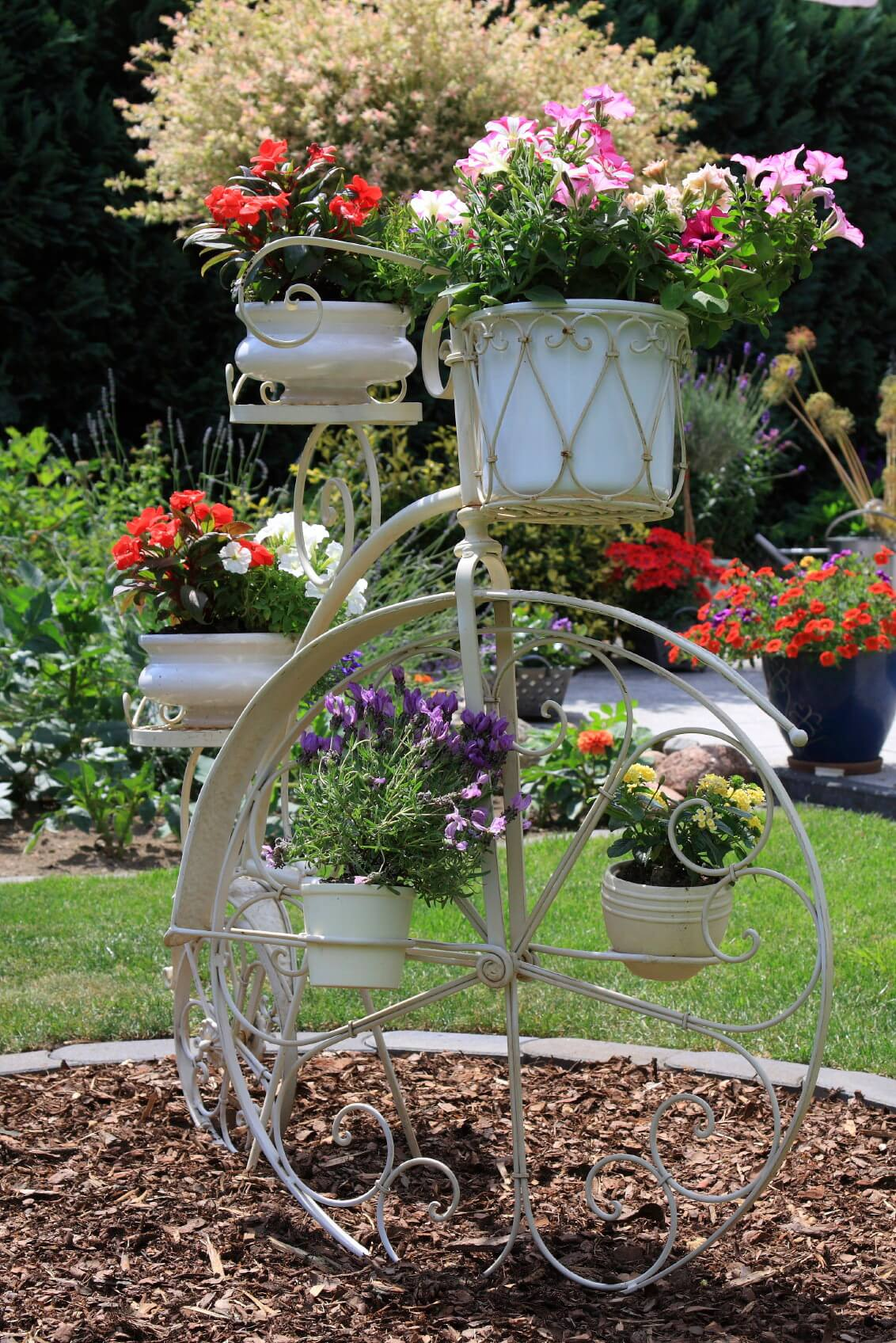 Here's a penny farthing bicycle flower planter.