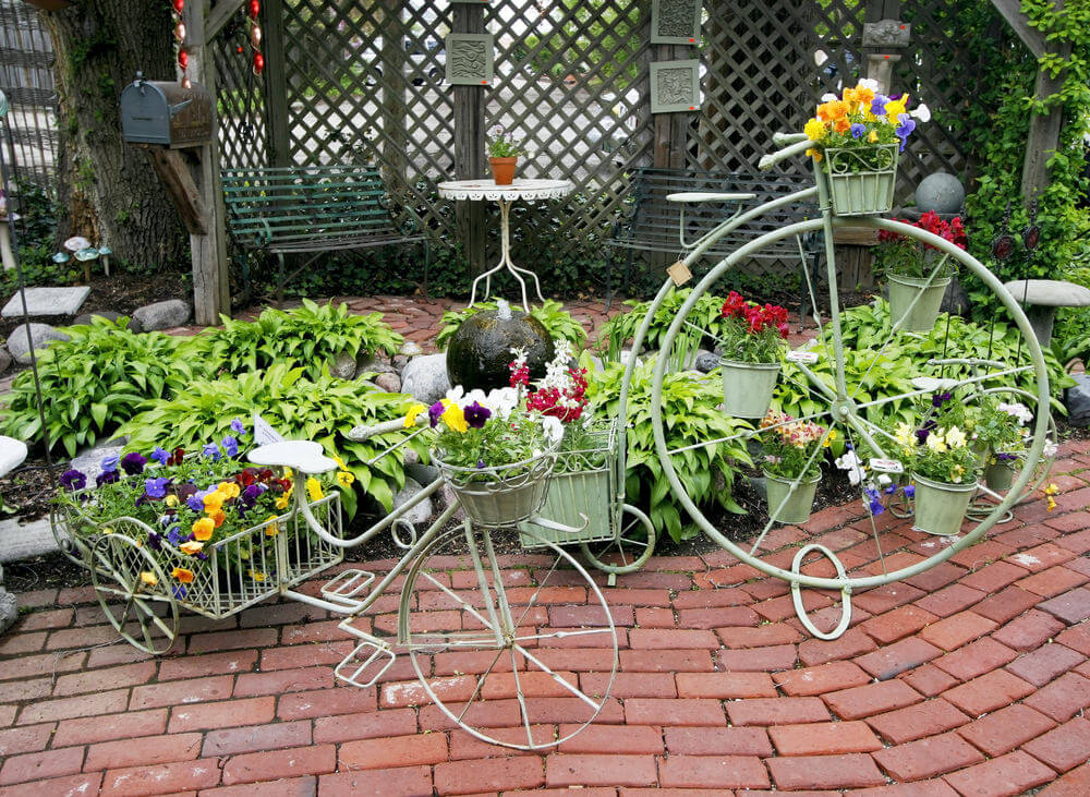 Penny farthing and old-style tricycle flower holders.