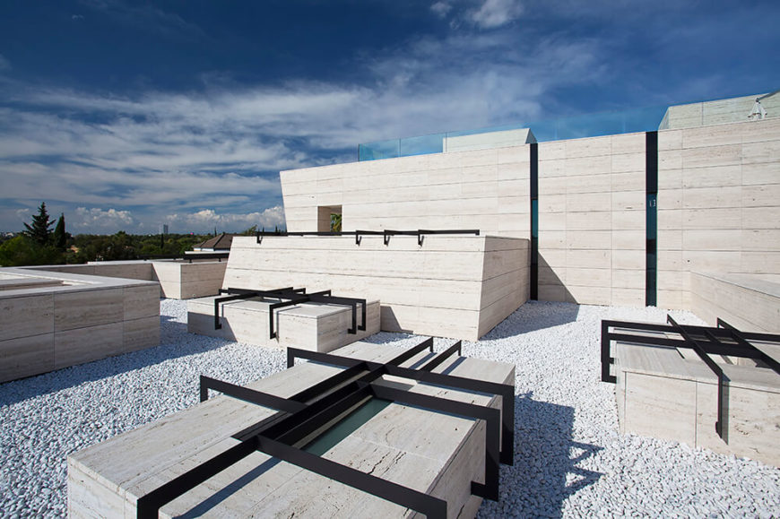 Even the rooftop is dripping with design. The light walls are enhanced with stone and black metal accents which give a dynamic and modern look that is both appealing and visually interesting.