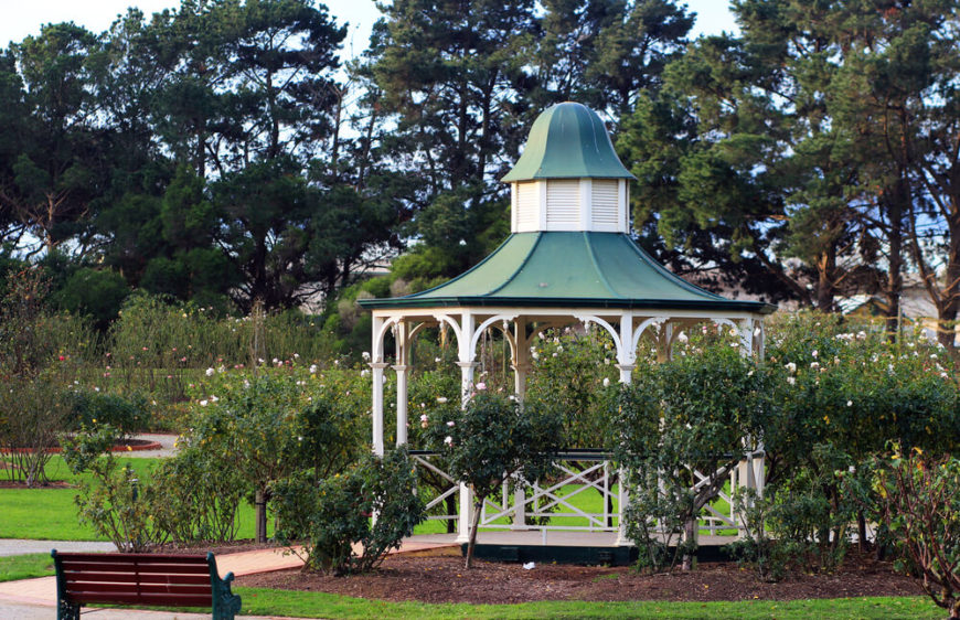 This gazebo sits in this space as a center of focus. A round gazebo can be placed in the center of a garden or set of trees to bring balance and symmetry to your space.