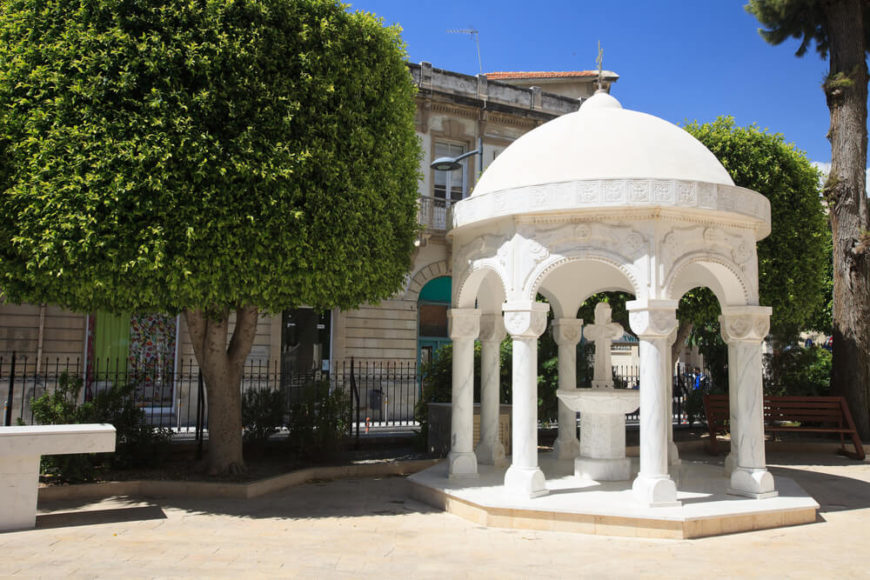 Unlike many gazebos that house seats and tables, or even a bench, this gazebo is a decorative space that holds a fountain underneath it. This makes it a great design feature that spruces up the landscaping.