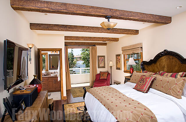 Even in rooms with lower ceilings, faux wooden beams are a great addition. The room gains architectural charm, without an incredible amount of renovation. Light fixtures can still be hung from the faux beams as well.