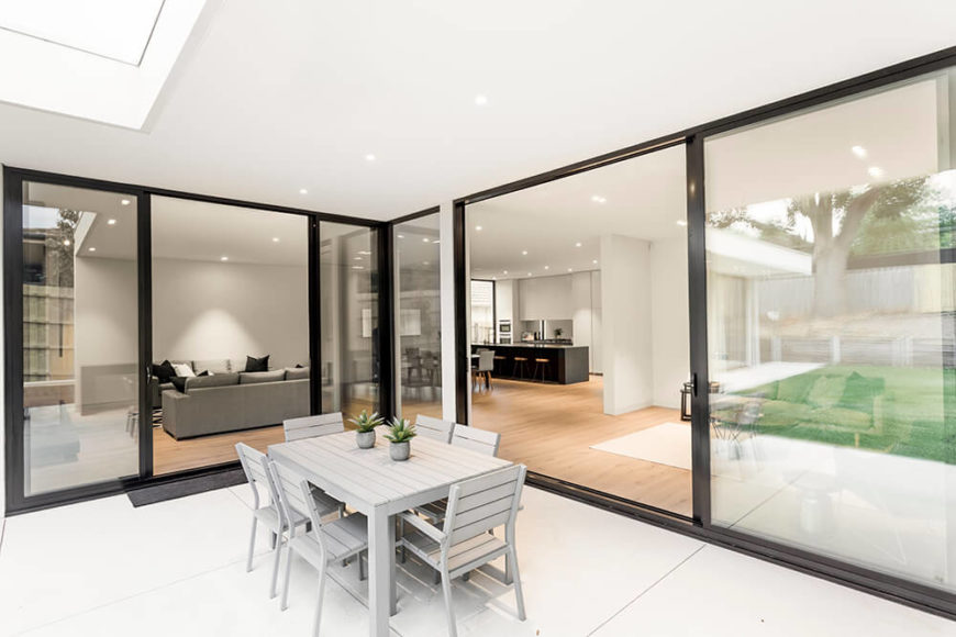 With a pair of large sliding glass panels connecting the patio to the interior, this space feels like a meetup between two major parts of the home. From here we can see clear across the interior.