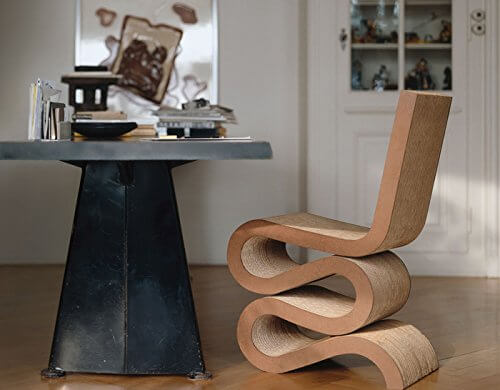 Here is a wiggle chair pulled up to a table. This comfortable chair will make your chair and table combo look fabulous and hip.
