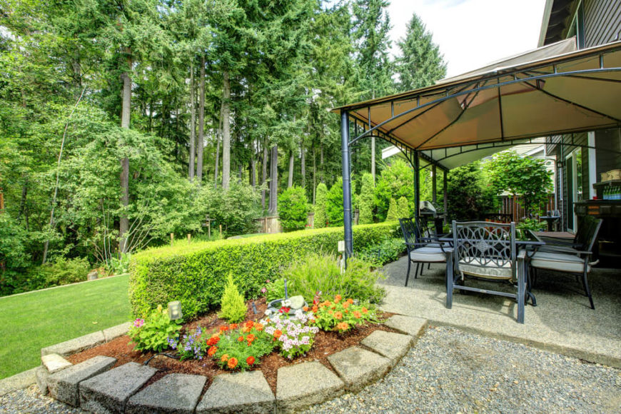 This patio has a beautiful small garden near the comfortable and shady gazebo. You can sit here in the shade and look out over the verdant landscape.