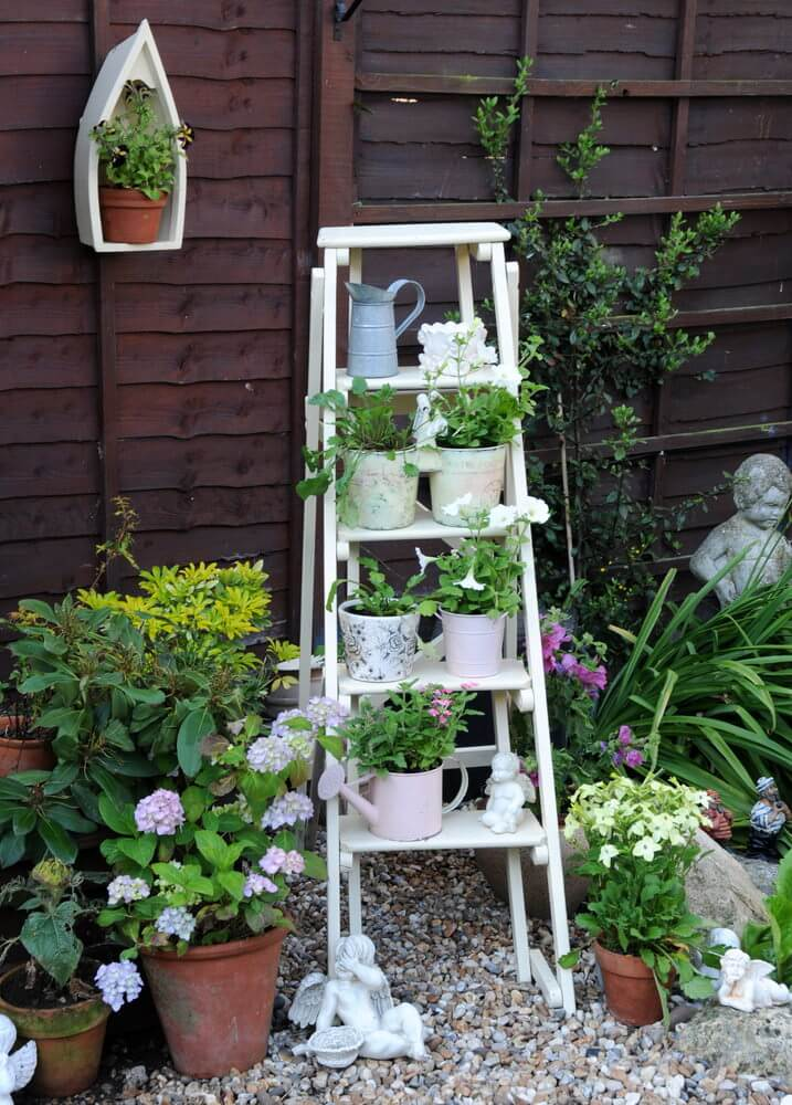 I love this ladder plant holder in white in a small garden off the patio. 35 Patio Potted Plant and Flower Ideas  Creative and Lovely Photos