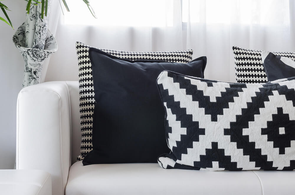 White Sofa With Black And White Pillows. Striking Effect. Pillows Include  Solid And Geometric