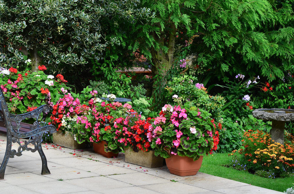 Terrific example of flower planters along the edge of a patio.