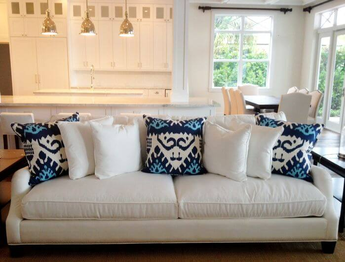 white sofa with and blue throw pillows