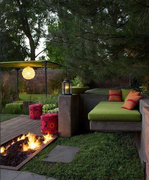 This square, flat-roofed gazebo is easy to set up in the garden and has space to wire a light, as shown. It sits above an outdoor sectional in green that seems to disappear into the greenery of this modern, organic-feeling backyard.