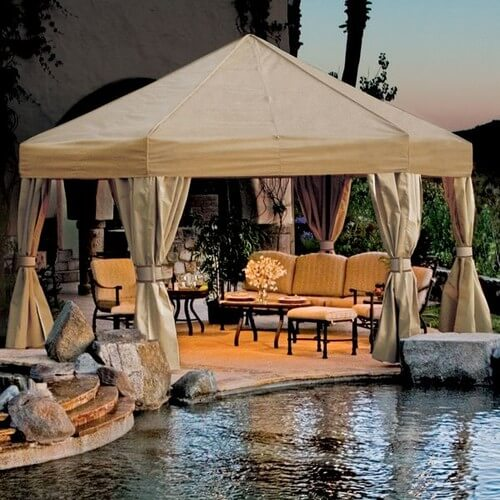 This gazebo is even closer to the poolside, and is large enough to fit a large sofa and two armchairs, in addition to tables and a footstool.