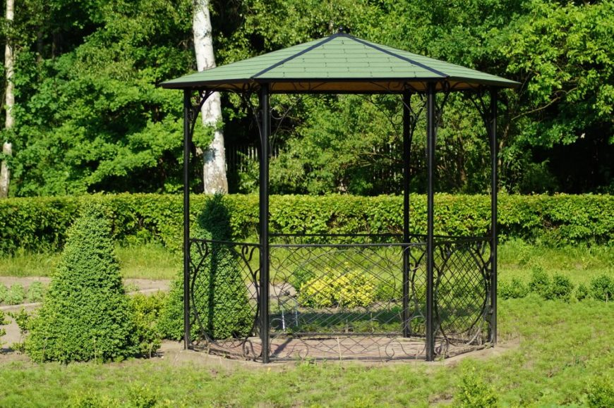 This is a smaller gazebo, but it has a hard roof and delicate aluminum features that enclose it. It's perfect for a small garden patio, and will sit two to three people comfortably.