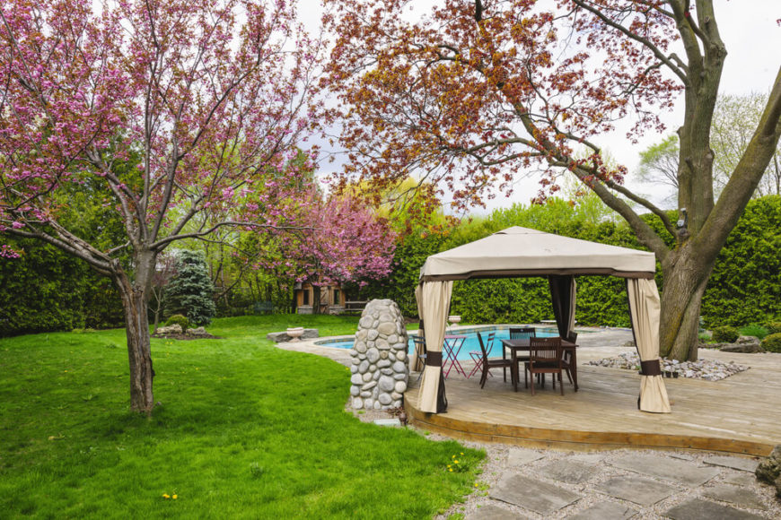 This is another great example of a poolside gazebo. Tiebacks keep the curtains away when you'd rather enjoy the breeze, and let the sides loose if privacy is what you'd prefer.