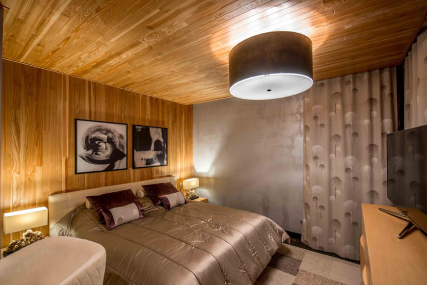 The master bedroom is absolutely awash in rich natural wood, even across the ceiling. This space is the warmest on the upper floor, reflecting the open plan first floor most closely.
