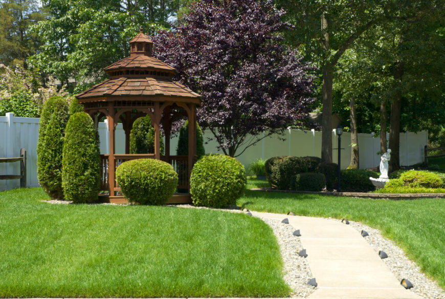 At the end of this lighted path is a small shady gazebo surrounded by shrubs and trees. This gazebo is perfect for escaping to when you need to relax in the shade and let the world vanish.