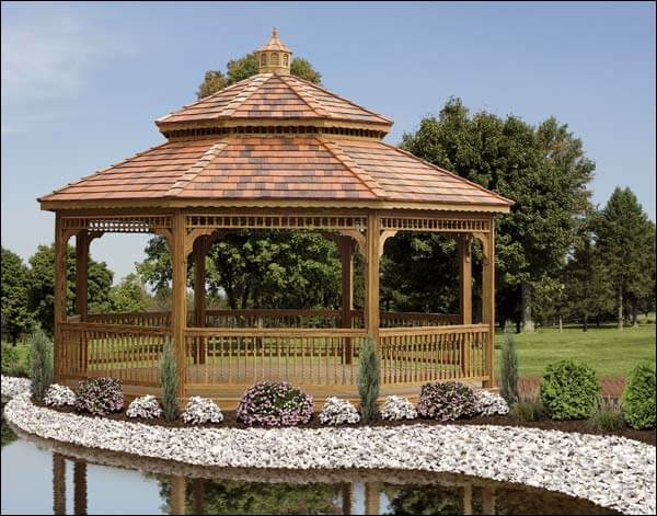 Next to the water this large wooden gazebo lined with a well-planned garden. The proper landscaping can make your gazebo mesh with its surroundings, and strengthen the feature.