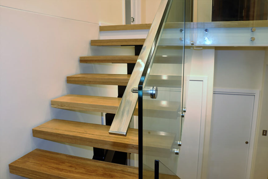 The floating timber steps and glass balustrades interact for a heightened, modern look. Touches like this help create a cohesive, contemporary feel within the home.