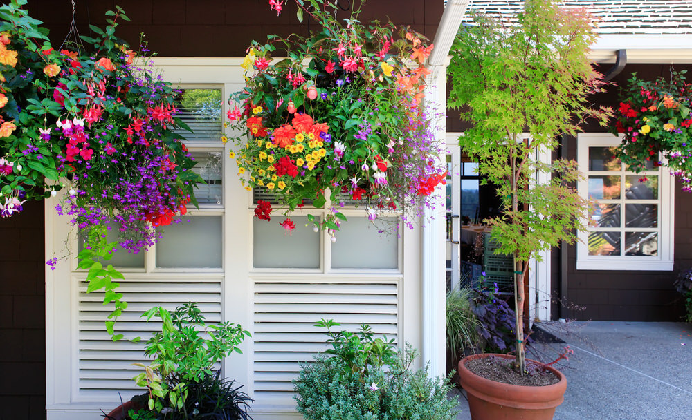 Wonderful Example Of How Hanging Flower Pots Can Really Dress Up The Space  Around The Home