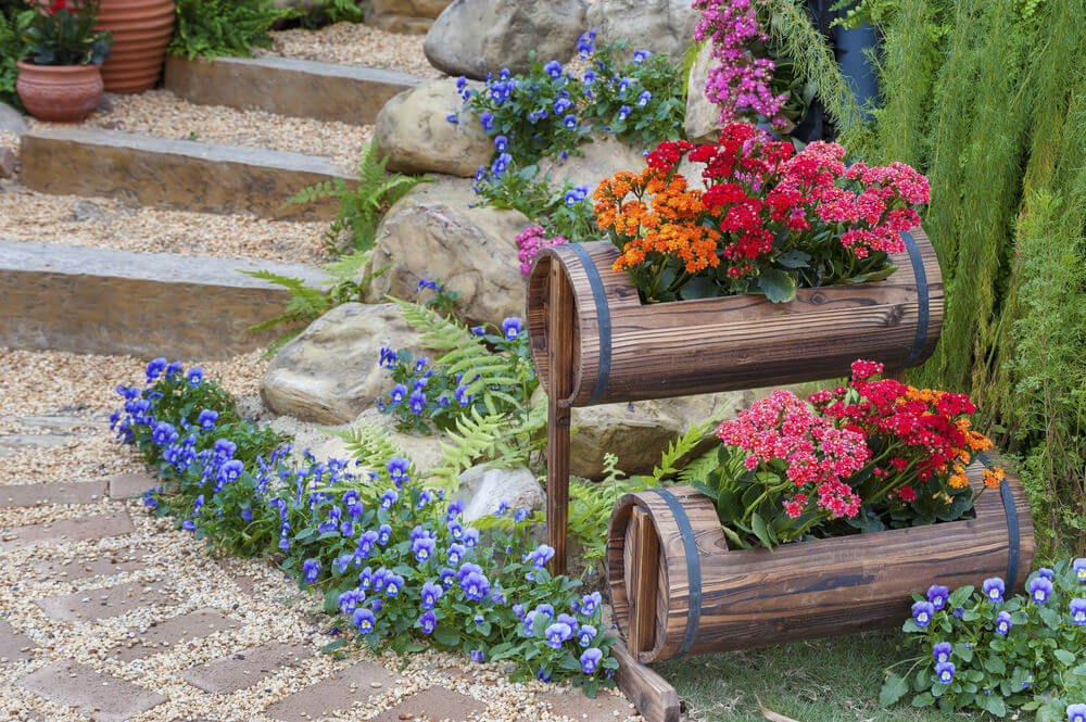 outdoor steps with small tiered barrel flower planters - Garden Ideas Using Pots